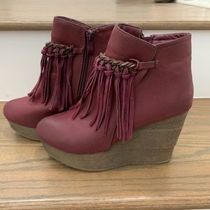 Cranberry colored wedge ankle booties with fringe